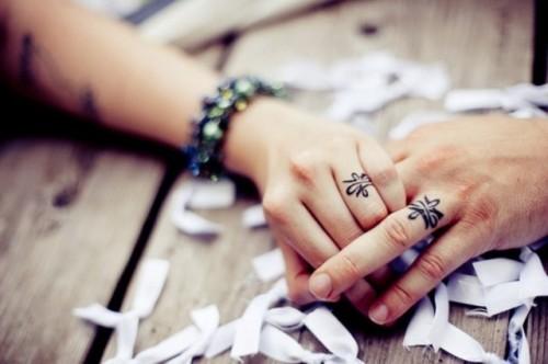 http://www.weddingomania.com/43-awesome-wedding-ring-tattoos/